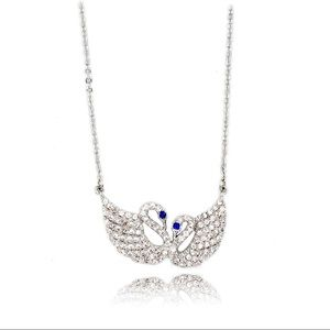 Double swan blue eye crystal necklace